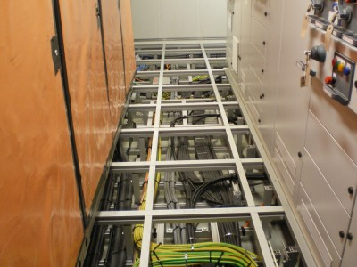 Alphastrut system for sub-floor cable management.